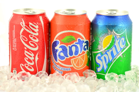Can of Coca-Cola, Fanta and Sprite drinks on ice