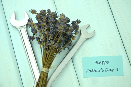 open end wrench: happy fathers day wishes, bunch of gorgeous dry lavender flowers and spanners Stock Photo