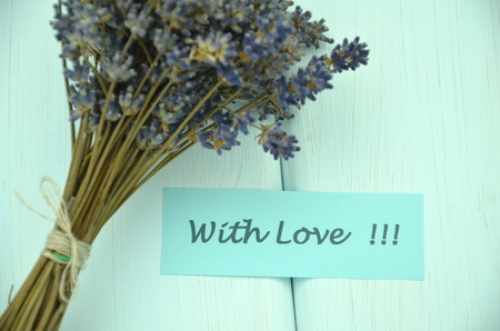 with love wishes and bouquet of delicate dry lavender flowers