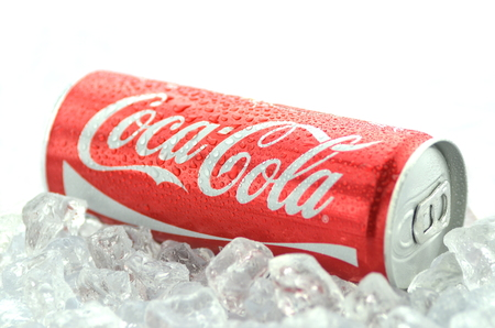 dewed: Can of Coca-Cola drink on ice Editorial