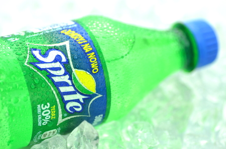 Bottle of Sprite drink on ice cubes