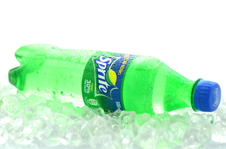 Bottle of Sprite drink on ice cubes Editorial