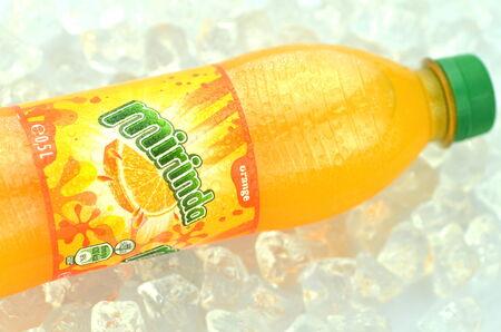 Bottle of Mirinda drink on ice cubes