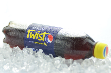 twist: Bottle of Pepsi Twist drink on ice cubes Editorial