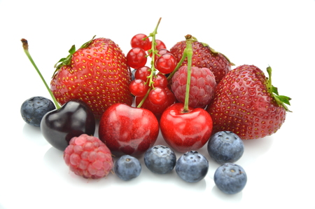variety of soft fruits, strawberries, raspberries, cherries, blueberries, currants isolated on white photo