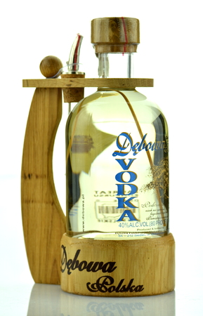 packshot: Debowa vodka with wooden handle isolated on white background Editorial