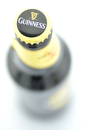 packshot: Guinness dry stout beer isolated on white background Editorial