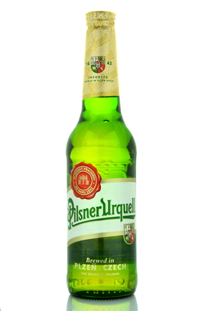 pilsner:  Pilsner Urquell pale lager beer isolated on white Editorial