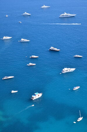 Gorgeous landscape, boats and yachts close to Capri island, Italy photo