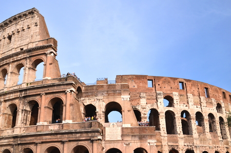 Majestic ancient Colosseum in Rome against blue sky, Italy photo