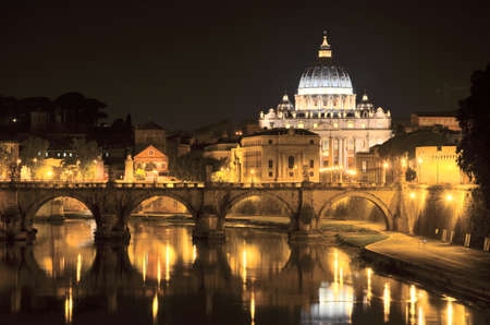 Monumental landscape of St. Peters Basilica over Tiber  at night  in Rome, Italy