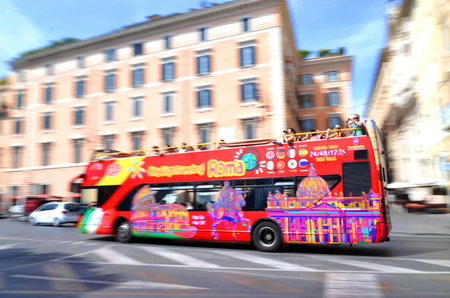 dashing: Dashing city sightseeing open top bus in Rome, Italy