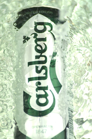 carlsberg: Carlsberg beer in splashed water Editorial