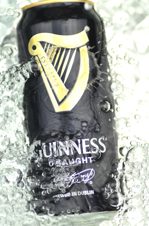 guinness beer: Guinness draught beer in splashed water. Editorial