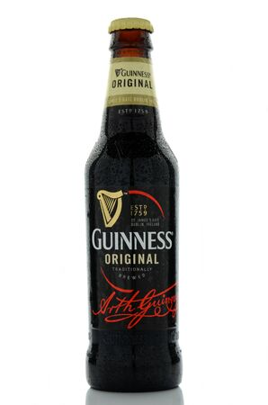 guinness beer: Guinness dry stout beer isolated on white background.