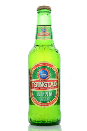 dewed: Tsingtao beer isolated on white background