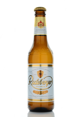 pilsner: Radeberger pilsner beer isolated on white background Editorial