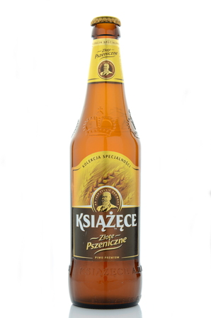 dewed: Ksiazece golden wheat beer isolated on white background. Editorial