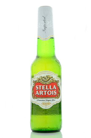 dewed: Stella Artois pilsner beer isolated on white background Editorial