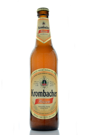 dewed: Krombacher wheat  beer isolated on white background