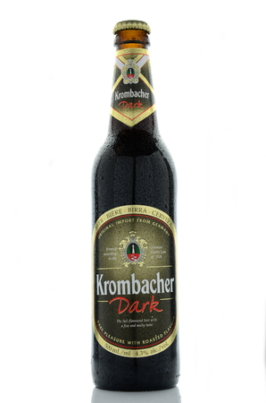 dewed: Krombacher dark  beer isolated on white background Editorial