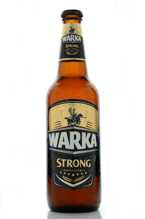 dewed: Warka strong beer isolated on white background. Editorial
