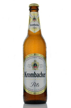 dewed: Krombacher pils beer isolated on white background.