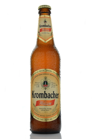 dewed: Krombacher wheat beer isolated on white background. Editorial
