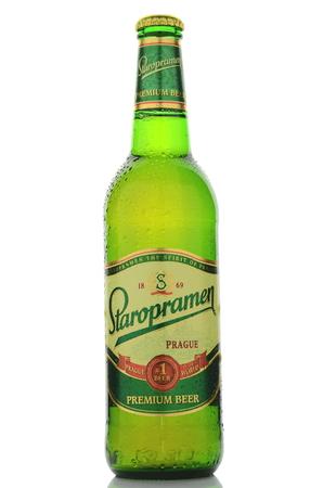 dewed: Staropramen premium beer isolated on white background Editorial