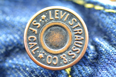 levi: Closeup of Levi Strauss button on blue jeans. Editorial