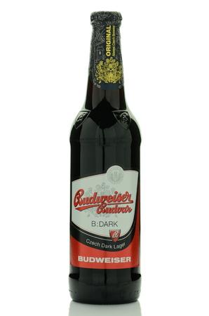 budvar: Dark lager Budweiser beer isolated on white background Editorial