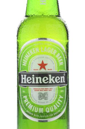 dewed: Heineken lager beer isolated on white background Editorial