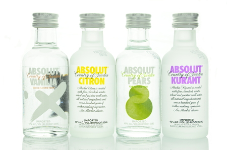 flavored: Variety of Absolut vodka flavored isolated on white background Editorial
