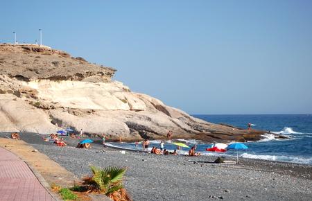 adeje: Beautiful black sand of Playa de la Enramada in Adeje on Tenerife, Spain Stock Photo