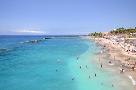 adeje: Gorgeous azure sandy Playa del Duque in Costa Adeje on Tenerife, Spain