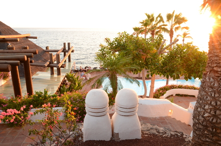 adeje: Picturesque beach club at sunset in Costa Adeje on Tenerife, Spain