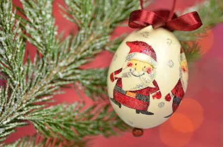 decoupage: Christmas bauble made by decoupage technique on bokeh background