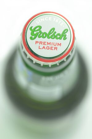 dewed: Grolsch premium lager beer isolated on white background Editorial