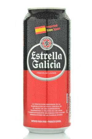 dewed: Estrella Galicia pale lager beer isolated on white background Editorial