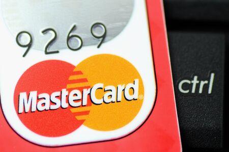mastercard: Closeup of MasterCard debit card on the control key Editorial