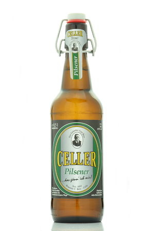 pilsener: Celler pilsener beer isolated on white background Editorial