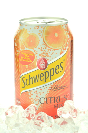 dewed: Can of Schweppes drink on ice cubes