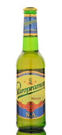 non alcoholic beer: Staropramen non alcoholic premium beer isolated on white. Editorial