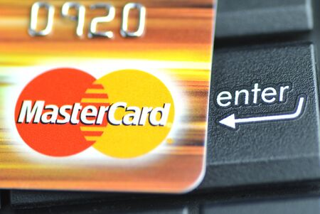 electronic commerce: Closeup of MasterCard debit card on laptop keyboard.