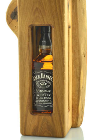 daniels: Bottle of Jack Daniels whiskey in decorative wooden box isolated on white background.
