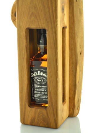 jack in a box: Bottle of Jack Daniels whiskey in decorative wooden box isolated on white background Editorial