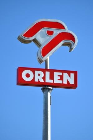 sign of Orlen against blue sky