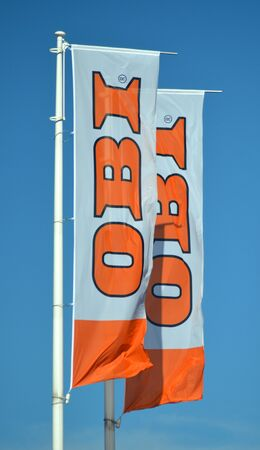 sign of OBI on waving flags against blue sky