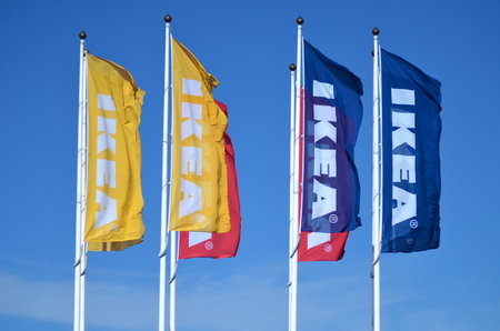 logo of ikea on waving flags against blue sky Editorial