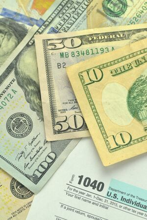 tax forms: closeup of us tax forms and us money Stock Photo